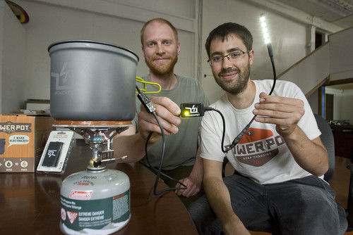 Paul Fraughton  |   Salt Lake Tribune   Paul Slusser and David Toledo show off their invention, The PowerPot, that can create power to run small electrical devices transforming the energy from heating water.                             Tuesday, May 28, 2013