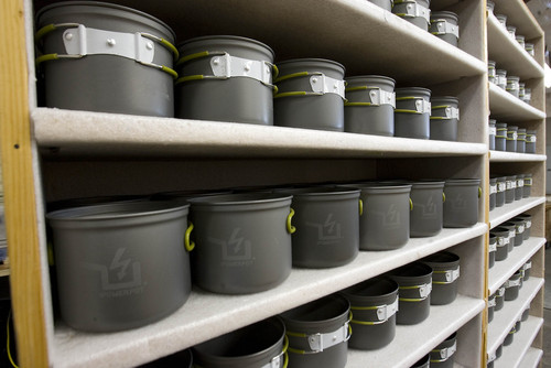 Paul Fraughton  |   Salt Lake Tribune    Camping pots are lined up ready to be turned into PowerPots.                            Tuesday, May 28, 2013
