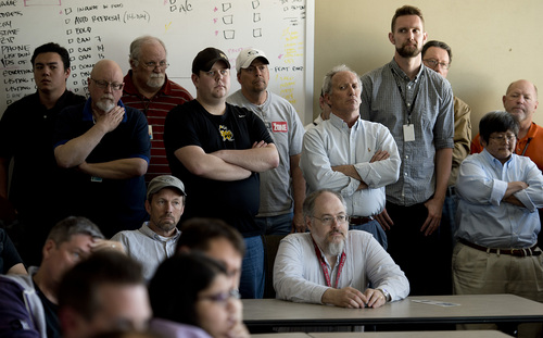 Jeremy Harmon  |  The Salt Lake Tribune  Members of The Salt Lake Tribune's staff listen as Editor and Publisher Terry Orme announces the elimination of eight positions during a staff meeting at the Tribune on Thursday, April 10, 2014.