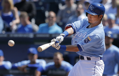 Kansas City Royals' Norichika Aoki hits an RBI triple off Tampa Bay Rays starting pitcher Jake Odorizzi during the fifth inning of a baseball game at Kauffman Stadium in Kansas City, Mo., Wednesday, April 9, 2014. (AP Photo/Orlin Wagner)