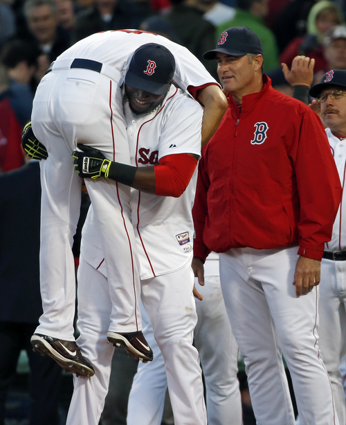 Boston Red Sox's David Ortiz picks up closer Koji Uehara as manager John Farrell, right, watches as they celebrate their 4-2 victory against the Texas Rangers in a baseball game at Fenway Park in Boston, Wednesday, April 9, 2014. (AP Photo/Elise Amendola)