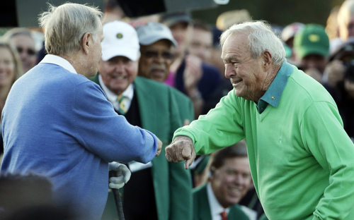 Arnold Palmer touches fists with Jack Nicklaus after hitting his ceremonial drive on the first tee during the first round of the Masters golf tournament Thursday, April 10, 2014, in Augusta, Ga.(AP Photo/Charlie Riedel)