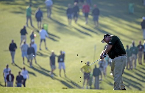 Craig Stadler hits off the first fairway during the first round of the Masters golf tournament Thursday, April 10, 2014, in Augusta, Ga. (AP Photo/Charlie Riedel)