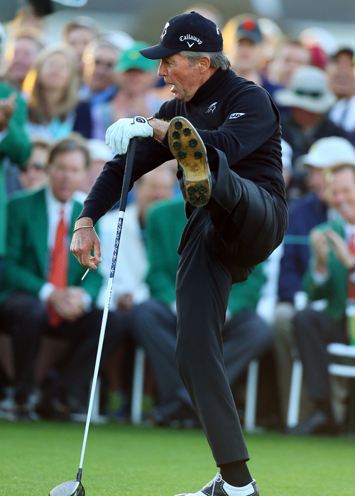 Gary Player kicks his leg up after hitting his ceremonial drive on the first tee during the first round of the Masters golf tournament Thursday, April 10, 2014, in Augusta, Ga. (AP Photo/Atlanta Journal-Constitution, Curtis compton)  MARIETTA DAILY OUT; GWINNETT DAILY POST OUT; LOCAL TV OUT; WXIA-TV OUT; WGCL-TV OUT