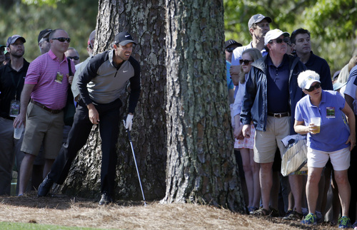 Charl Schwartzel, of South Africa, follows his ball after hitting out of the rough off the first fairway during the first round of the Masters golf tournament Thursday, April 10, 2014, in Augusta, Ga. (AP Photo/Darron Cummings)