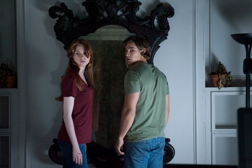 "|  Relativity Media Kaylie (Karen Gillan) and Tim (Brenton Thwaites) are siblings obsessed with a haunted mirror, in the horror thriller ""Oculus."""