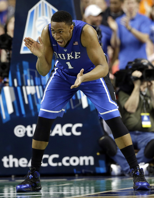 FILE - In this March 16, 2014 file photo, Duke's Jabari Parker (1) celebrates after making a basket against Virginia during the second half of an NCAA college basketball game in the championship of the Atlantic Coast Conference tournament in Greensboro, N.C. Parker was selected to The Associated Press All-America team, released Monday, March 31, 2014.  (AP Photo/Gerry Broome)