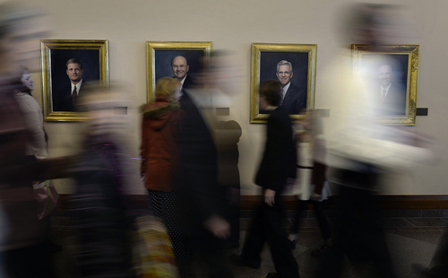 Scott Sommerdorf   |  The Salt Lake Tribune People pass portraits of members of the Quorum of the Twelve Apostles at the afternoon session of the 184th General Conference of the Church of Jesus Christ of Latter Day Saints, Sunday, April 6, 2014.