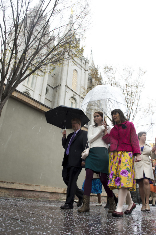 Steve Griffin  |  The Salt Lake Tribune   Members and supporters of the Ordain Women, led by Hannah Wheelwright and Kate Kelly, walk in front of the Temple on their way to the Tabernacle on Temple Square to seek standby tickets to the all-male general priesthood meeting in Salt Lake City, Utah Saturday, April 5, 2014.