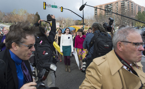 Steve Griffin  |  The Salt Lake Tribune   Media members scramble to keep ahead of members and supporters of the Ordain Women, led by Hannah Wheelwright and Kate Kelly, center, as they walk to the Tabernacle on Temple Square to seek standby tickets to the all-male general priesthood meeting in Salt Lake City, Utah Saturday, April 5, 2014.