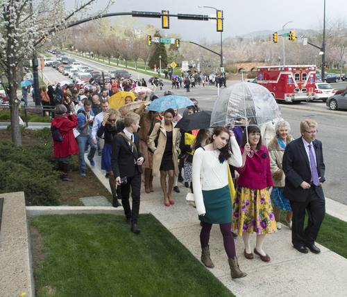 Steve Griffin  |  The Salt Lake Tribune   Members and supporters of the Ordain Women, led by Hannah Wheelwright and Kate Kelly, center, walk to the Tabernacle on Temple Square to seek standby tickets to the all-male general priesthood meeting in Salt Lake City, Utah Saturday, April 5, 2014.