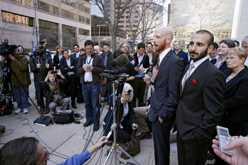 Plaintiffs challenging Utah's gay marriage ban Moudi Sbeity, right, and his partner Derek Kitchen, take questions from the media after leaving court following a hearing at the U.S. Circuit Court of Appeals in Denver, Thursday, April 10, 2014. The court is to decide if it agrees with a federal judge in Utah who in mid-December overturned a 2004 voter-passed gay marriage ban, saying it violates gay and lesbian couples' rights to due process and equal protection under the 14th Amendment. (AP Photo/Brennan Linsley)