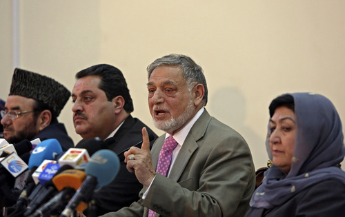 Ahmad Yousuf Nouristani, chairman of the Independent Election Commission, from right second, speaks during a press conference in Kabul, Afghanistan, Sunday, April 13, 2014. Partial results released Sunday in Afghanistan's crucial presidential election show a tight race between ex-foreign minister Abdullah Abdullah, with 41.9 percent of the vote, and former finance minister Ashraf Ghani, with 37.6 percent. (AP Photo/Rahmat Gul)