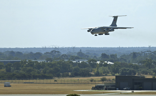 A Chinese  Ilyushin IL-76 aircraft lands at Perth International Airport after returning from the ongoing search operations for missing Malaysia Airlines Flight 370 in Perth, Australia, Sunday, April 13, 2014. Following four strong underwater signals in the past week, all has gone quiet in the hunt for the missing Malaysian airline, meaning the batteries on the all-important black boxes may have finally died. Despite having no new pings to go on, crews are continuing their search Sunday for debris and any sounds that could still be emanating. (AP Photo/Rob Griffith)
