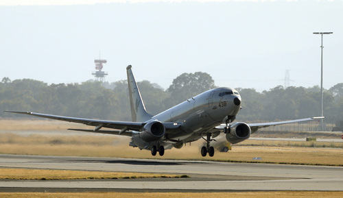 A U.S. Navy P8 Poseidon takes off from Perth Airport en route to rejoin the ongoing search operations for missing Malaysia Airlines Flight 370 in Perth,  Australia, Sunday, April 13, 2014. Military planes and ships from seven nations continue to scourer the Indian Ocean off the coast of western Australia for Flight 370 in one of the largest maritime multi-nation searches in history. (AP Photo/Rob Griffith)