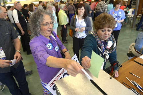Leah Hogsten  |  The Salt Lake Tribune l-r Carol Evans of Taylorsville and Jan Ferre of Salt Lake City cast their ballots for candidates at the Salt Lake County Democratic convention on Saturday at West Jordan Middle School.
