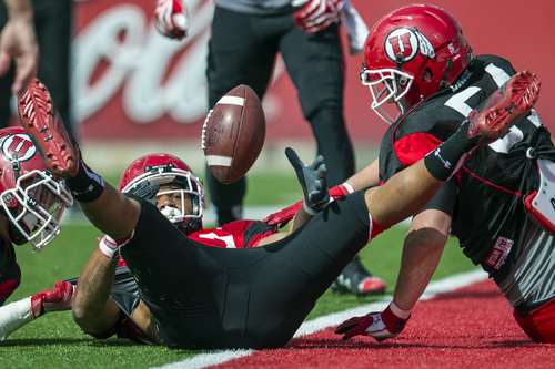 Chris Detrick  |  The Salt Lake Tribune Utah Utes running back Devontae Booker (27) looses control of the ball while being stopped at the goal line by Utah Utes Tanner Larsen during a scrimmage at Rice-Eccles Stadium DOW} April 12, 2014.