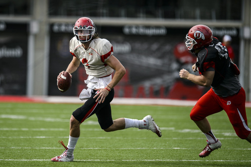 Chris Detrick  |  The Salt Lake Tribune Utah Utes quarterback Travis Wilson (7) runs from Utah Utes defensive end Hunter Dimick (49) during a scrimmage at Rice-Eccles Stadium DOW} April 12, 2014.