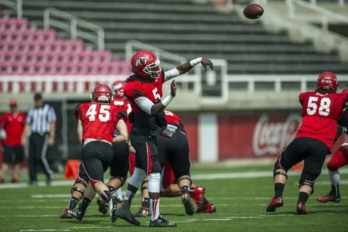 Chris Detrick  |  The Salt Lake Tribune Utah Utes quarterback Brandon Cox (5) passes the ball during a scrimmage at Rice-Eccles Stadium DOW} April 12, 2014.