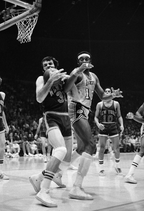 Los Angeles Lakers' Wilt Chamberlain and New York Knicks' Jerry Lucas (32) get their arms tangled up as they battle for a rebound during an NBA playoff game at the Forum in Inglewood, Calif., Thursday, May 11, 1973. Lucas got control of the ball. The Knicks won, 102-93, to capture the NBA championship series, 4-1. (AP Photo/Rau Stubblebine)12206 - Oneg.