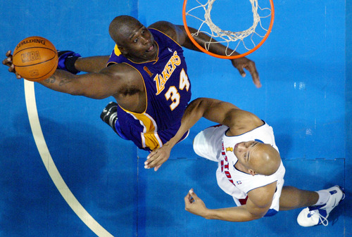 Los Angeles Lakers center Shaquille O'Neal prepares to dunk the ball on Detroit Pistons forward Darvin Ham during the fourth quarter of their NBA Finals in Auburn Hills, Mich., Sunday, June13, 2004. (AP Photo/Al Goldis)