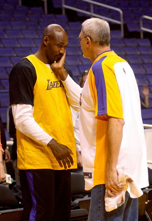 Los Angeles Lakers' Karl Malone and coach Phil Jackson, right, talk Monday, June 7, 2004, during a team practice in Los Angeles. The Detroit Pistons beat the Lakers in the first game of the NBA finals Sunday. (AP Photos/Michael Tweed)