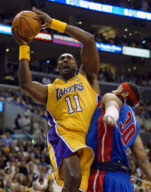 Los Angeles Lakers' Karl Malone goes up for basket over Detroit Pistons' Rasheed Wallace during the first quarter of Game 2 of the NBA Finals, Tuesday, June 8, 2004, in Los Angeles. (AP Photo/Mark J. Terrill)