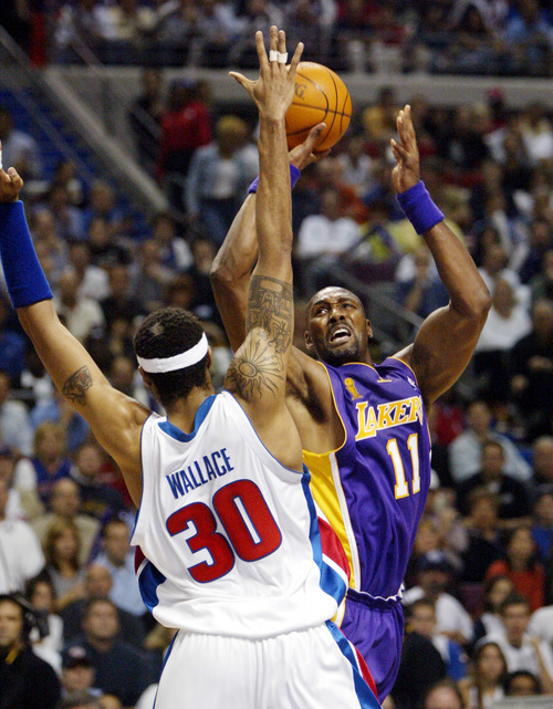 Los Angeles Lakers forward Karl Malone shoots over the defense of Detroit Pistons forward Rasheed Wallace, (30) during the first quarter of game 3 of the NBA Finals at the Palace in Auburn Hills, Mich., Thursday, June 10, 2004. (AP Photo/Paul Sancya)