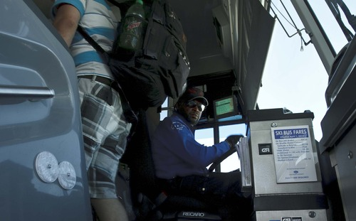Leah Hogsten  |  Tribune file photo Riders board the 902 Salt Lake City to Park City UTA bus last summer. Changes -- including a fare reduction -- have helped boost ridership on the line by an average of 1,000 per month even though there are fewer trips.