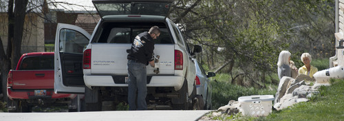 Steve Griffin     The Salt Lake Tribune  Sandee Wall, a next door neighbor, far right, talks with a man and women at the house where seven dead infants were found April 13, 2014 in this Pleasant Grove, Utah home. Police believe Megan Huntsman, 39, gave birth to the babies then killed them over the past decade. The home was photographed Monday April, 14, 2014.