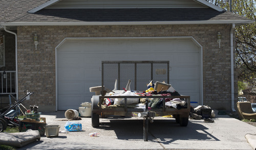 Steve Griffin     The Salt Lake Tribune  Household items are scattered about the lawn and driveway at the house where seven dead infants were found April 13, 2014 in Pleasant Grove, Utah. Police believe Megan Huntsman, 39, gave birth to the babies then killed them over the past decade. The home was photographed Monday April, 14, 2014.