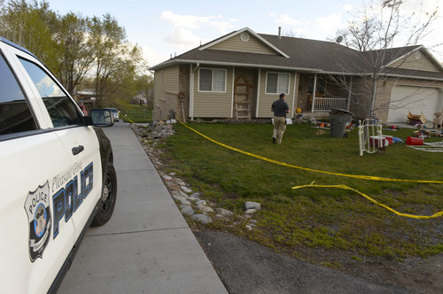 Leah Hogsten     The Salt Lake Tribune On Sunday, April 13, 2014, Pleasant Grove Police investigators enter the  home where 7 dead babies were discovered on April 13, 2014. 39-year-old Megan Huntsman was arrested and booked on suspicion of six counts of murder. Police say she may have had the babies and killed them all over the last decade. Police believe she gave birth to the babies then killed them over the past decade, according to a police news release.