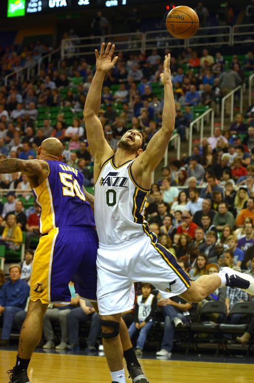 Rick Egan  |  The Salt Lake Tribune  Utah Jazz center Enes Kanter (0) goes for a rebound along with Los Angeles Lakers center Robert Sacre (50), in NBA action, The Utah Jazz vs. The Los Angeles Lakers, at EnergySolutions Arena, Monday, April 14, 2014