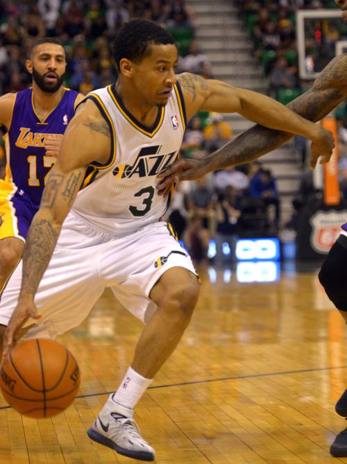 Rick Egan  |  The Salt Lake Tribune  Utah Jazz guard Trey Burke (3) brings the ball down court,  in NBA action, The Utah Jazz vs. The Los Angeles Lakers, at EnergySolutions Arena, Monday, April 14, 2014