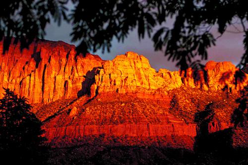 Trent Nelson  |   Tribune file photo The sun sets on Zion National Park peaks overlooking Springdale, Thursday, October 10, 2013.
