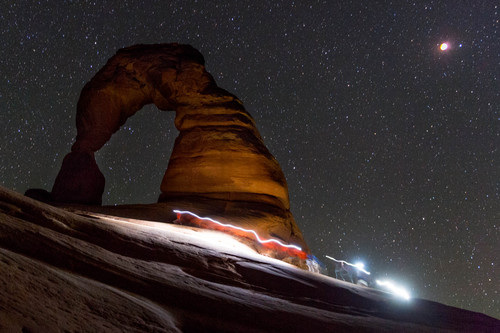 Trent Nelson  |  The Salt Lake Tribune Onlookers of the total lunar eclipse at Delicate Arch in Arches National Park, Tuesday April 15, 2014.