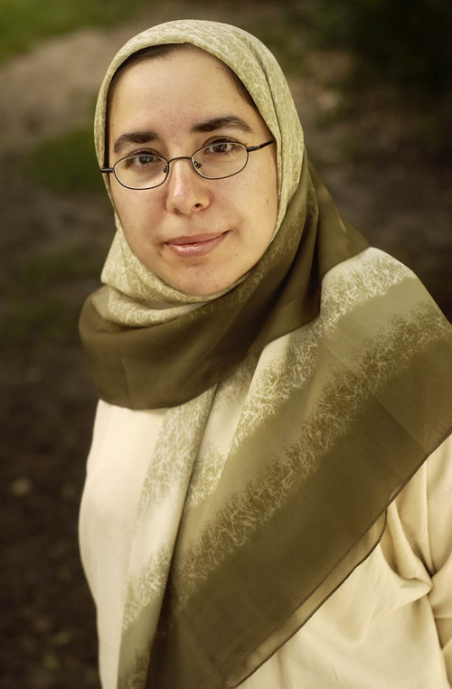Muslim women wear headscarves as a sign of faith and identity, while teaching, speaking, leading -- even doing police work. We showed our readers both the distinctiveness and similarities of the Islamic community. Ryan Galbraith/photograph 07/02/04