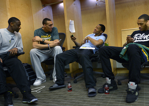 Scott Sommerdorf   |  The Salt Lake Tribune Utah Jazz players, Ian Clark, left, Rudy Gobert, Trey Burke, and Malcolm Thomas, right, talk and check their cell phones in the locker room on the day the Jazz clean out their lockers after a disappointing 25-57 season, Thursday, April 17, 2014.