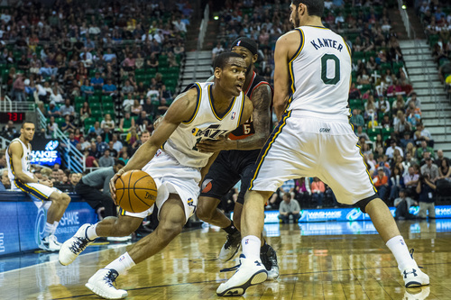 Chris Detrick  |  The Salt Lake Tribune Utah Jazz guard Alec Burks (10) runs past Portland Trail Blazers guard Will Barton (5) during the game at EnergySolutions Arena Friday April 11, 2014. Portland is winning the game 53-51 at halftime.