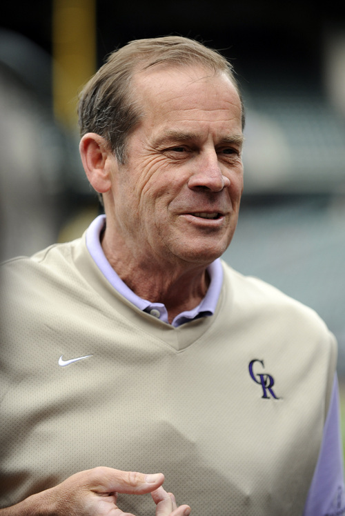 Colorado Rockies owner, chairman and chief executive officer, Dick Monfort looks on during batting practice before a baseball game between the New York Yankees and the Colorado Rockies on Tuesday, May 7, 2013, in Denver. (AP Photo/Jack Dempsey)