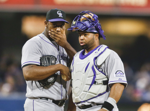 Colorado Rockies starting pitcher Juan Nicasio and catcher Wilin Rosario have a talk during a long first inning in which  Nicasio gave up two runs to the San Diego Padres in a baseball game Tuesday, April 15, 2014, in San Diego. (AP Photo/Lenny Ignelzi)