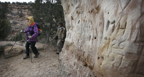 "Scott Sommerdorf  |  The Salt Lake Tribune Part of the ""Great Old Broads"" group hikes past a rock formation with what they call ""Bubba Glyphs"" in Recapture Canyon near Blanding, Saturday, April 9, 2011. The group hiked ""Lem's Trail"" in order to point out areas that should be protected, and also to show areas that have been improved for atv use."