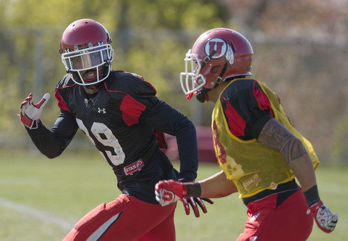 Steve Griffin  |  The Salt Lake Tribune   University of Utah corner back Reginald Porter, left, runs up field with Karl Williams during punt coverage drills at spring football practice at the Spence Eccles Football Facility in Salt Lake City, Utah Tuesday, April 8, 2014.