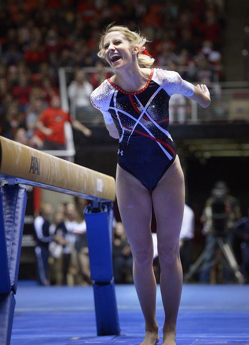 Scott Sommerdorf      The Salt Lake Tribune Mary Beth Lofgren reacts to her 9.925 score on the balance beam as the Utah Red Rocks beat Arizona 197.825 to 194.425, Friday, Feb. 7, 2014.