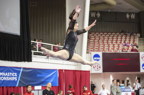 Courtesy Kory Mortensen  |  University of Utah Corrie Lothrop performs on the beam at the NCAA Regional Gymnastics Championships in Fayetteville, Ark.