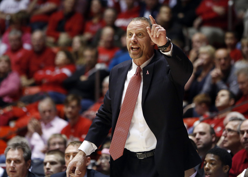 Utah coach Larry Krystkowiak talks to his team during the first half of an NCAA college basketball game against Washington State in Salt Lake City, Saturday, Feb. 8, 2014. Utah won 81-63. (AP Photo/Jim Urquhart)