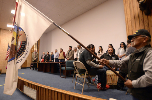 Al Hartmann  |  The Salt Lake Tribune Flag ceremony of American and Tribe with traditional drum circle start a ceremony at Fort Duchesne Tuesday April 15 where members of the Ute Tribe Business Committee and University of Utah  signed a renewed memorandum of understanding outlining the University's continued use of the Ute name for its athletics teams.