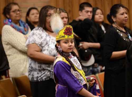 Al Hartmann  |  The Salt Lake Tribune Members of the Ute tribe young and old attend a ceremony at Fort Duchesne Tuesday April 15 where a memorandum of understanding was signed outlining the University's continued use of the Ute name for its athletics teams.  Little Miss Ute Tribe Sundae Pargeets, 11, attends in her ceremonial dress.