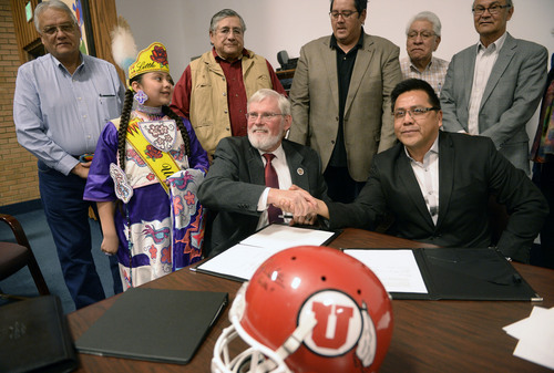 Al Hartmann  |  The Salt Lake Tribune David W. Pershing, University of Utah president, front left, and Gordon Howell, chairman of the Ute Indian Tribe Business Committee shake hands after signing a memorandum of understanding outlining the Universityís continued use of the Ute name for its athletics teams.  Members of the Ute Business Committe in rear watched the signing at a ceremony at Fort Duchesne Tuesday April 15.