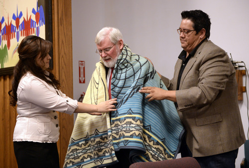 Al Hartmann  |  The Salt Lake Tribune David W. Pershing, University of Utah president, receives a ceremonial blanket as a gift from members of the Ute tribe after signing an understanding outlining the Universityís continued use of the Ute name for its athletics teams.  The signing took place at a ceremony in Fort Duchesne Tuesday April 15.